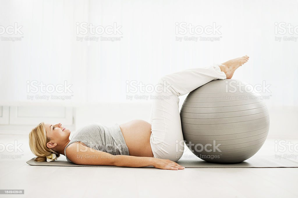 Beautiful pregnant woman doing exercises. royalty-free stock photo