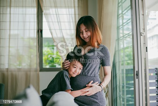 Asian beautiful pregnant woman enjoy her pregnancy with her son at home