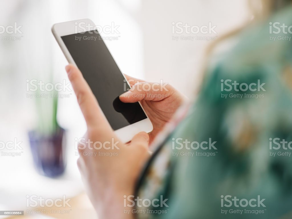 Beautiful Pregnant Woman With Smart Phone In The Kitchen Stock Photo Download Image Now Istock