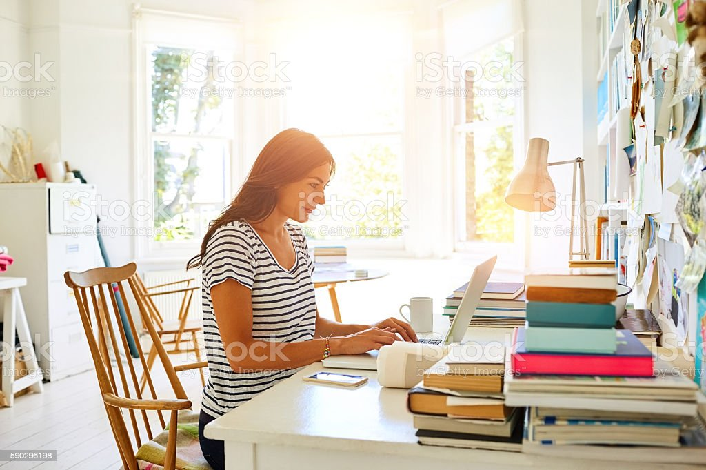Beautiful pregnant woman working from home office stock photo