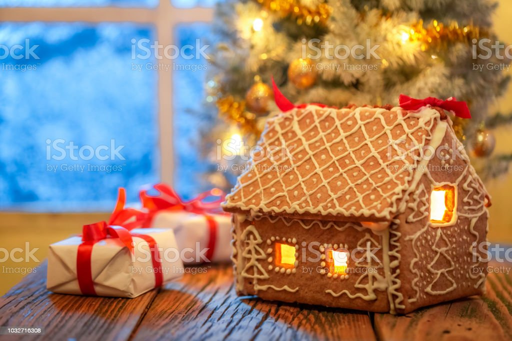 add6409868b Beautiful presents and Christmas tree with frozen window and light - Stock  image .