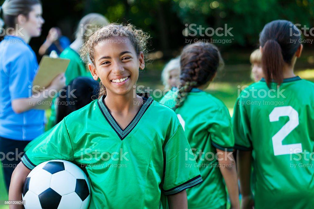 Beautiful preteen female soccer player stock photo