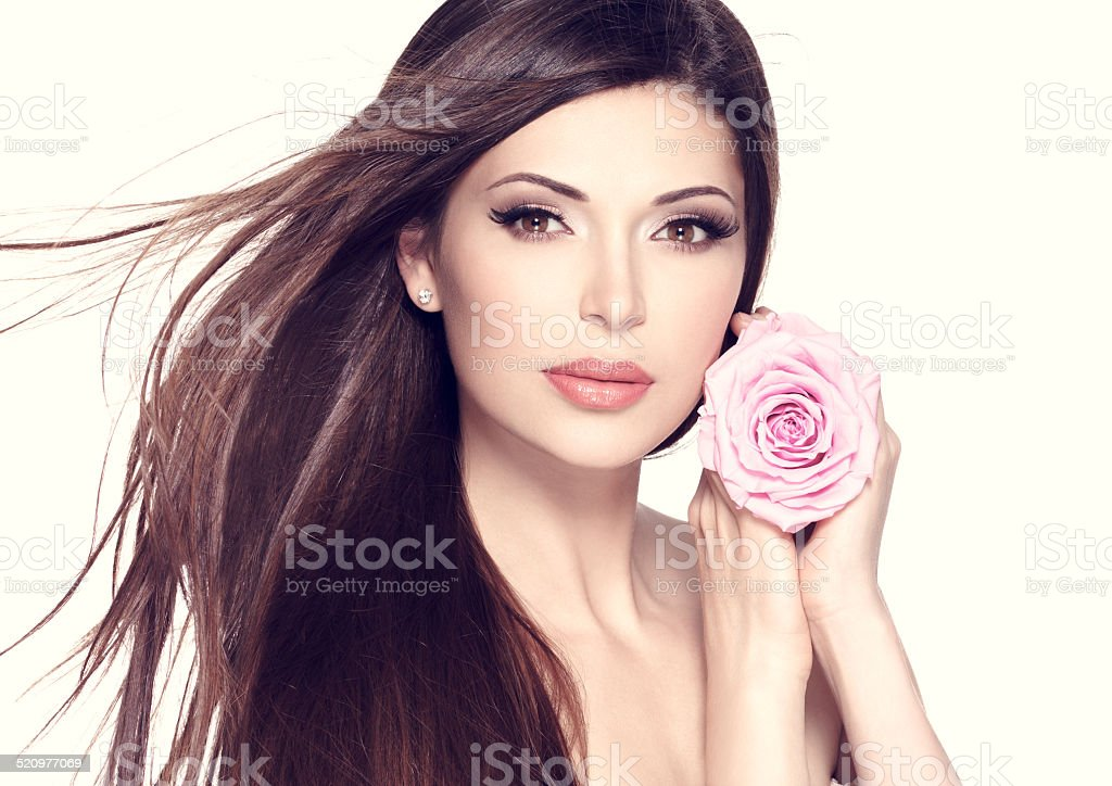 beautiful pretty woman with long hair and pink rose stock photo