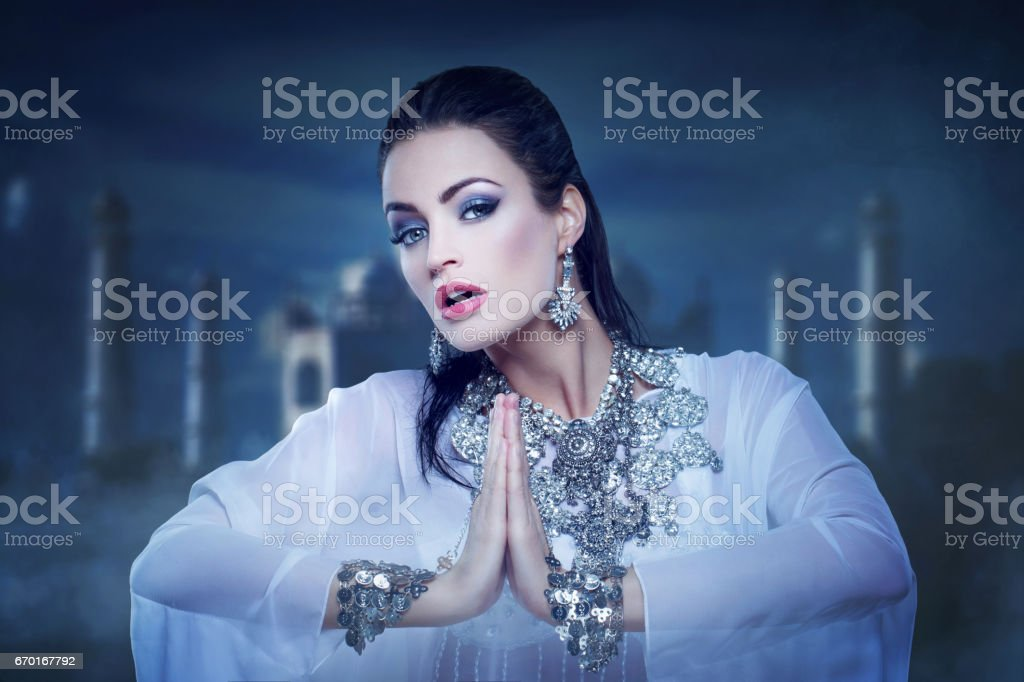 Beautiful princess belly dancing in orient night stock photo