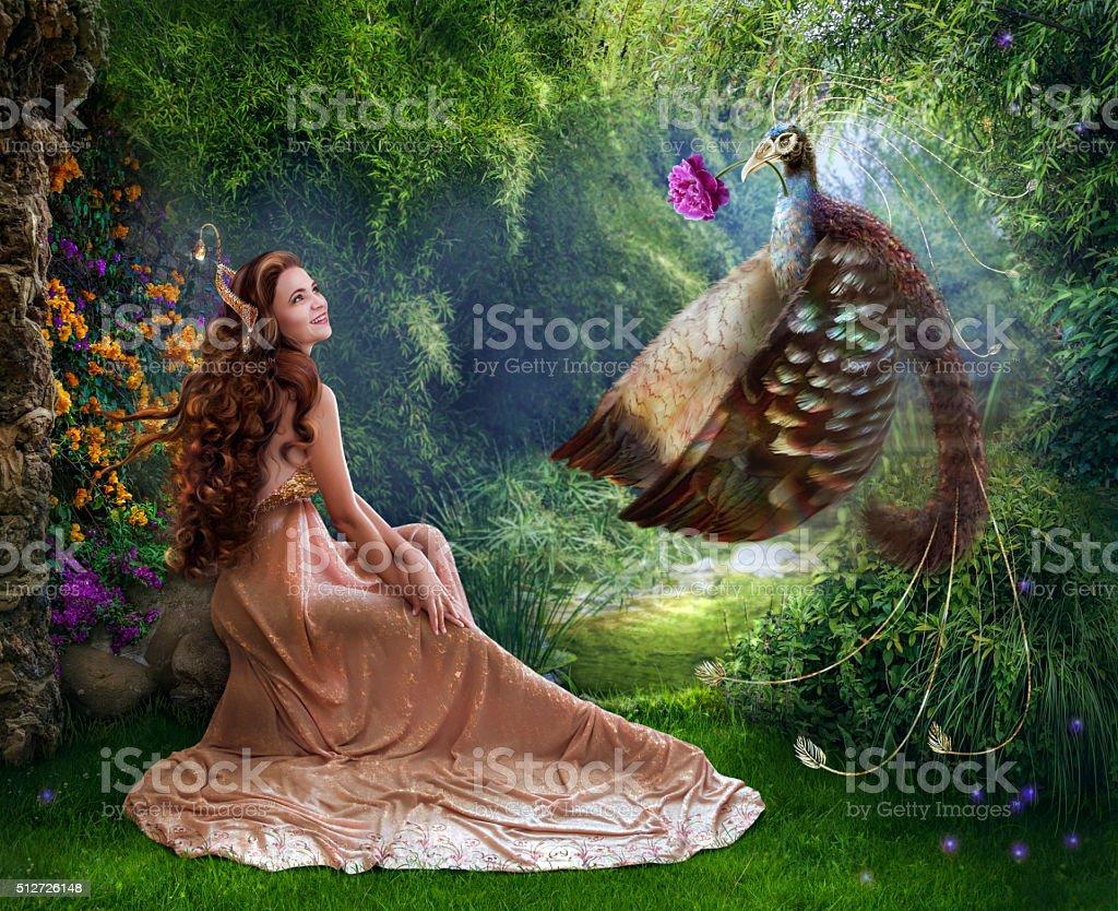 Beautiful princess with fabulous bird photo art stock photo