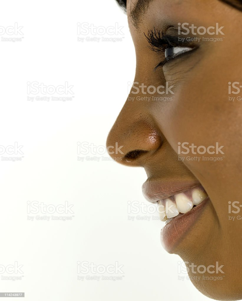 A beautiful profile of a woman smiling stock photo