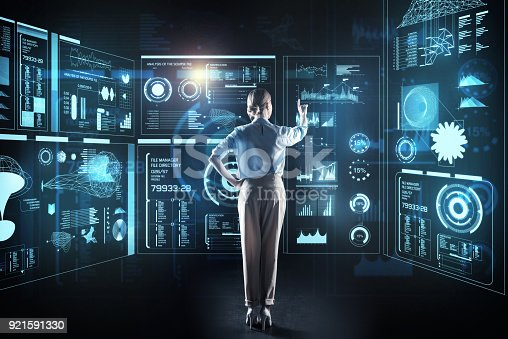 istock Beautiful programmer looking elegant while being at work 921591330