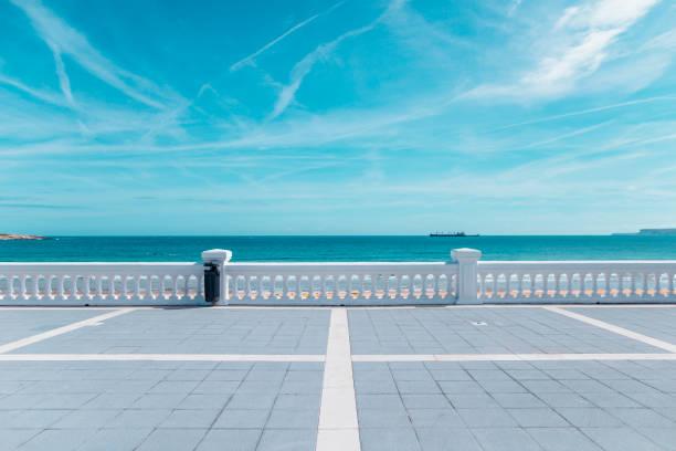 Beautiful promenade by the sea Beautiful promenade with white fence by the sea promenade stock pictures, royalty-free photos & images