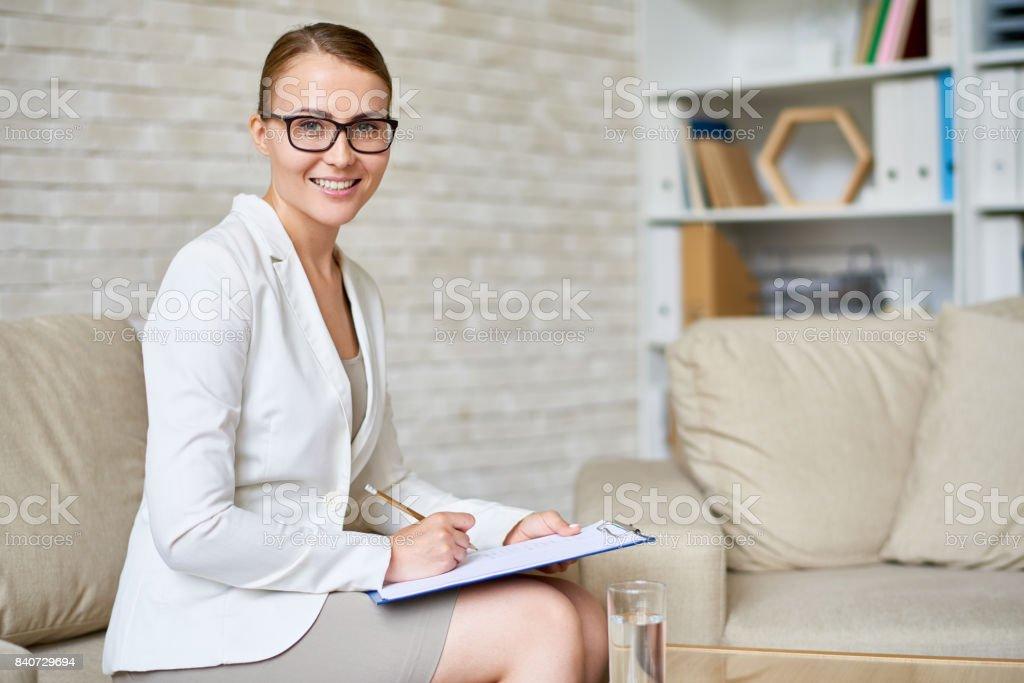 Beautiful Psychiatrist Posing in Office stock photo
