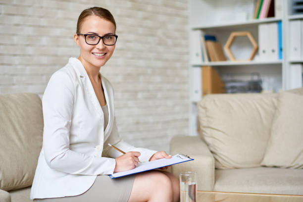 beautiful psychiatrist posing in office - psychiatrist stock photos and pictures