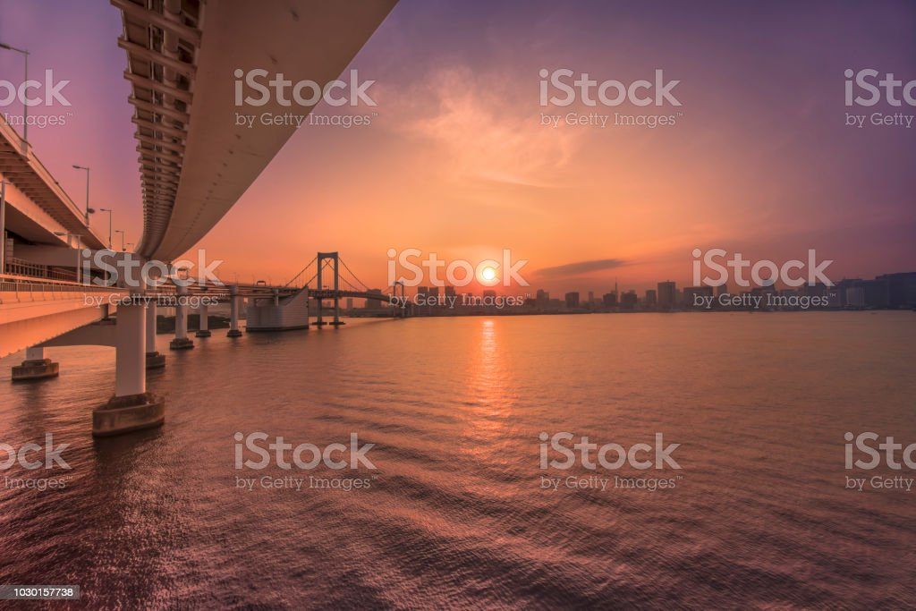 Beautiful Purple Sunset View From Rainbow Bridge Of Hamamatsucho And Hinode Coast In Tokyo Bay With The Tokyo Tower In Background Stock Photo Download Image Now Istock