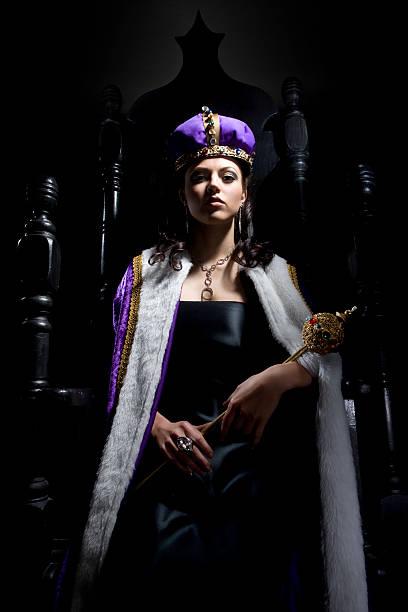 black throne with beautiful queen holding scepter - tron sci fi bildbanksfoton och bilder