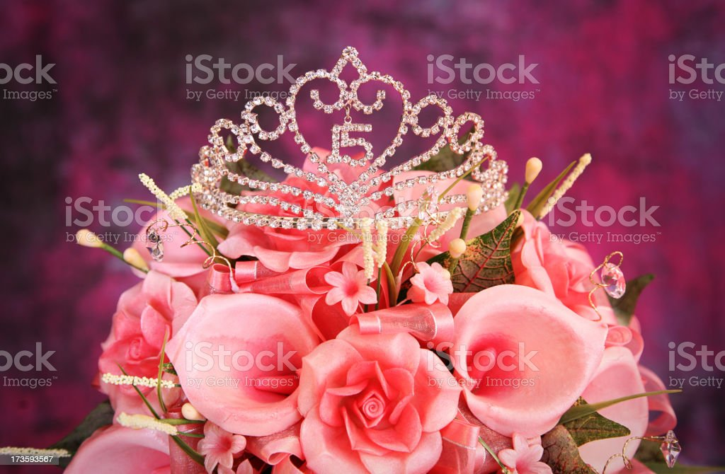 Beautiful Quinceanera Crown on top of pink flowers stock photo