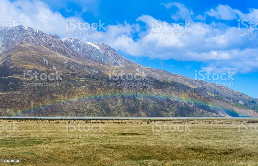 Beautiful Rainbow at Tasman Glacier Valley stock photo