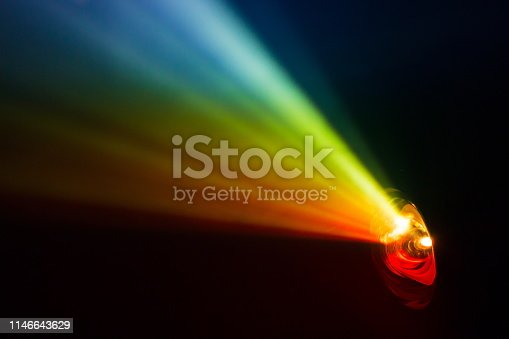 beautiful rainbow color wide lens projector with light beam for movie and cinema at night . smoke texture spotlight . screening for multimedia . black background .