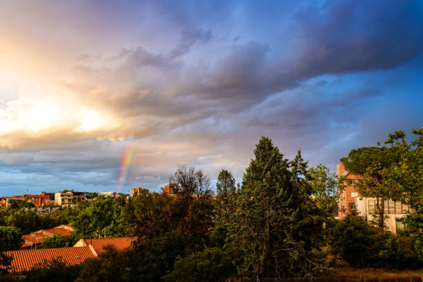 Beautiful rainbow of residential district at sunset stock photo
