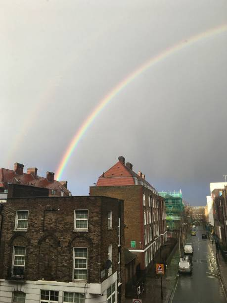 A beautiful rainbow over Camden in London. stock photo