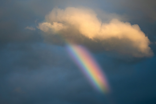 Beautiful rainbow spectrum in the sky after rain. Colourful phenomena in the clouds. Nobody