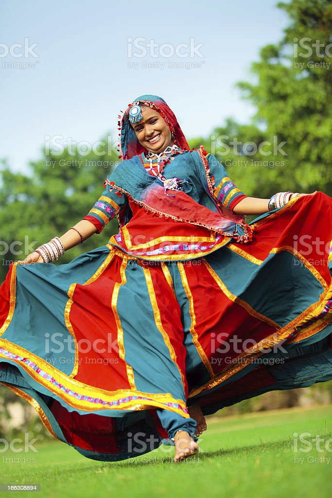 beautiful rajasthani girl running on grass royalty-free stock photo