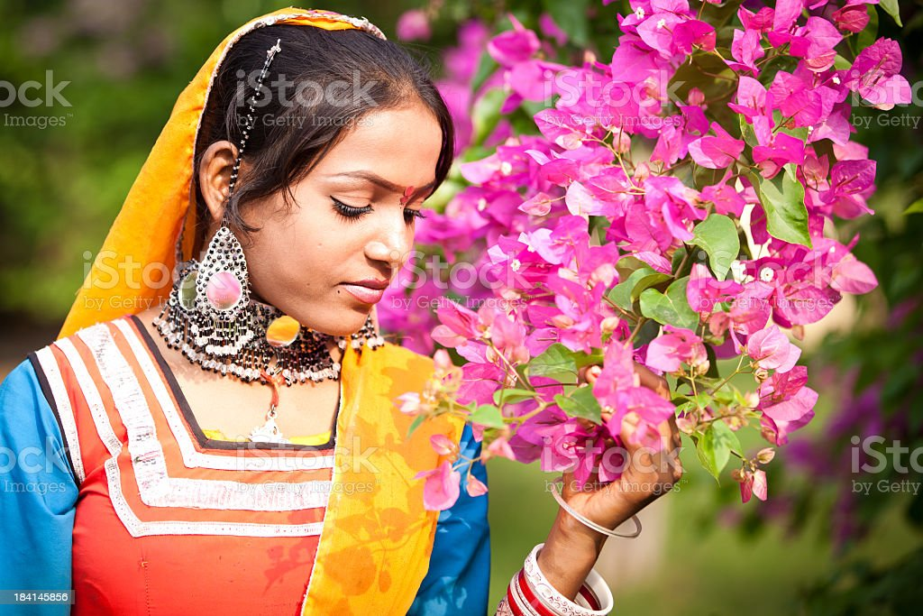 beautiful rajasthani girl with flowers royalty-free stock photo
