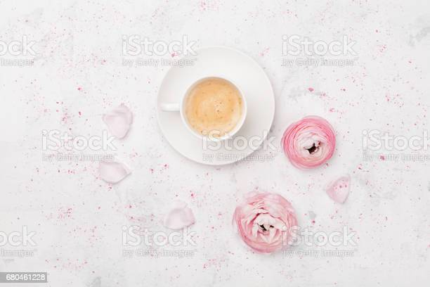 Beautiful ranunculus flowers and cup of coffee breakfast in pastel picture id680461228?b=1&k=6&m=680461228&s=612x612&h=ygder 0egd4oy2n72vpivbwoukedwuhdoajjkcxqvgu=