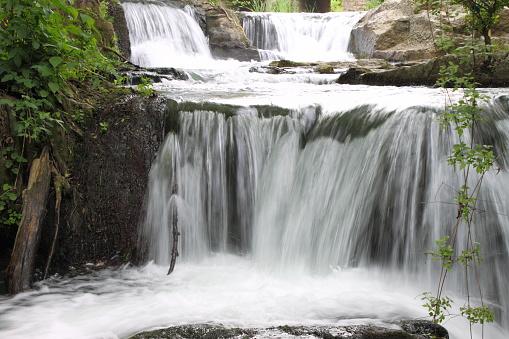 Beautiful rapids between vegetation near Monte Gelato waterfalls. Rome, Italy