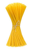 Beautiful raw spaghetti pasta. Spaghetti bunch or cooking ingredient, isolated on white background. Closeup shot, top view.