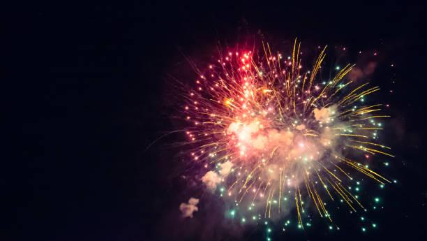 beautiful real fireworks during celebration - fourth of july стоковые фото и изображения