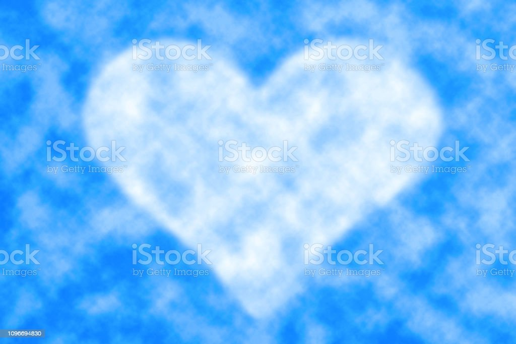 Beautiful realistic fluffy cloud in shape of heart in center of blue...