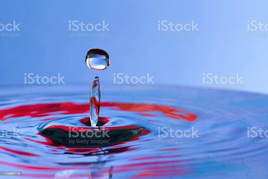 Beautiful red and blue water drop with splash royalty-free stock photo