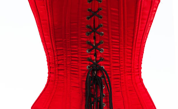 Beautiful red female corse Beautiful red female corset with black lacing on a white background corset stock pictures, royalty-free photos & images
