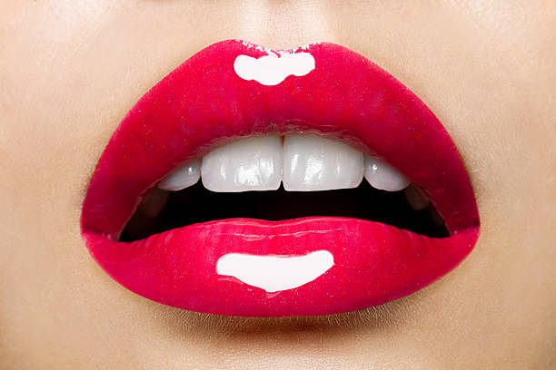 beautiful red female lips with glitter - human lips stock photos and pictures