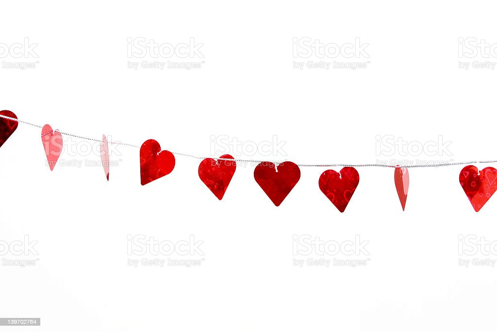 Beautiful red hearts hanging on a line in white background stock photo