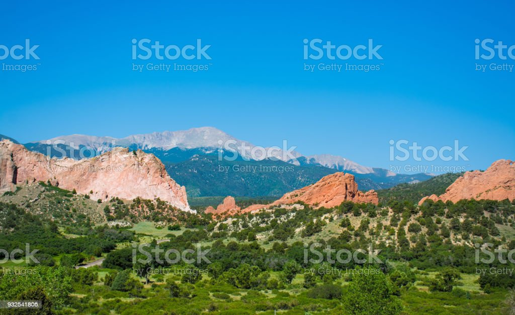 Beautiful red mountains and green hills. stock photo