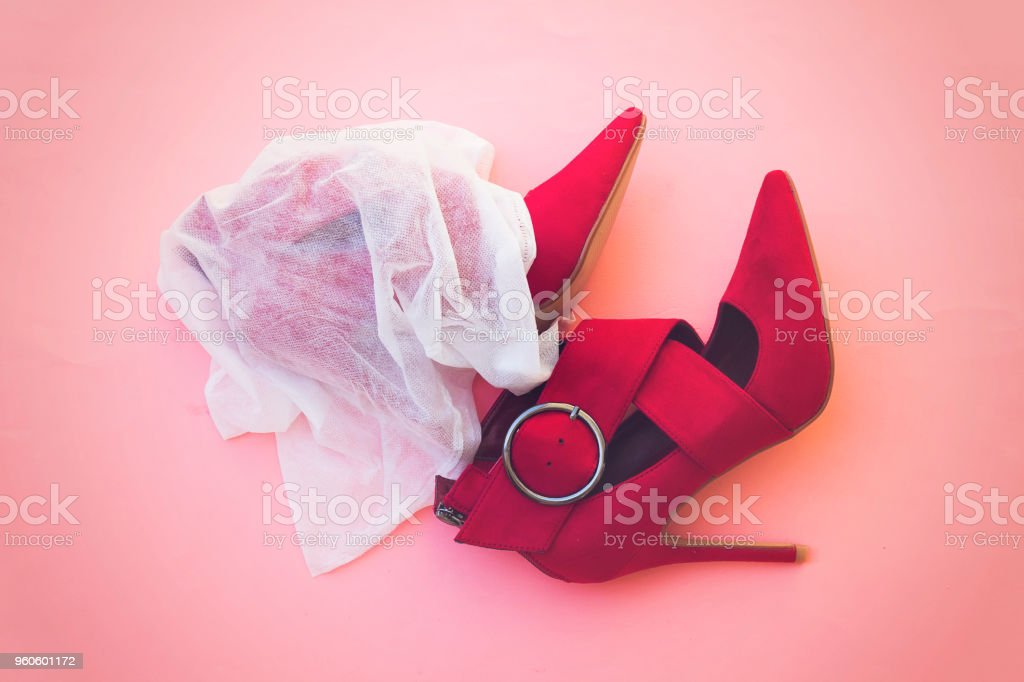 beautiful red pump hight heeled on pink background stock photo