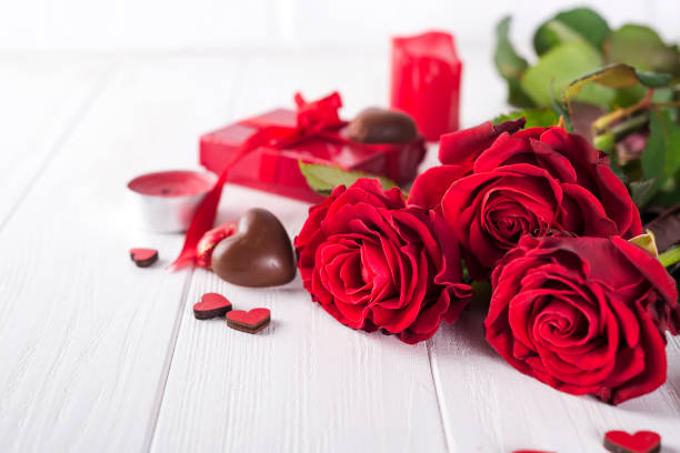Beautiful red rose and dark chocolate for valentine day for Valentine's Day stock photo