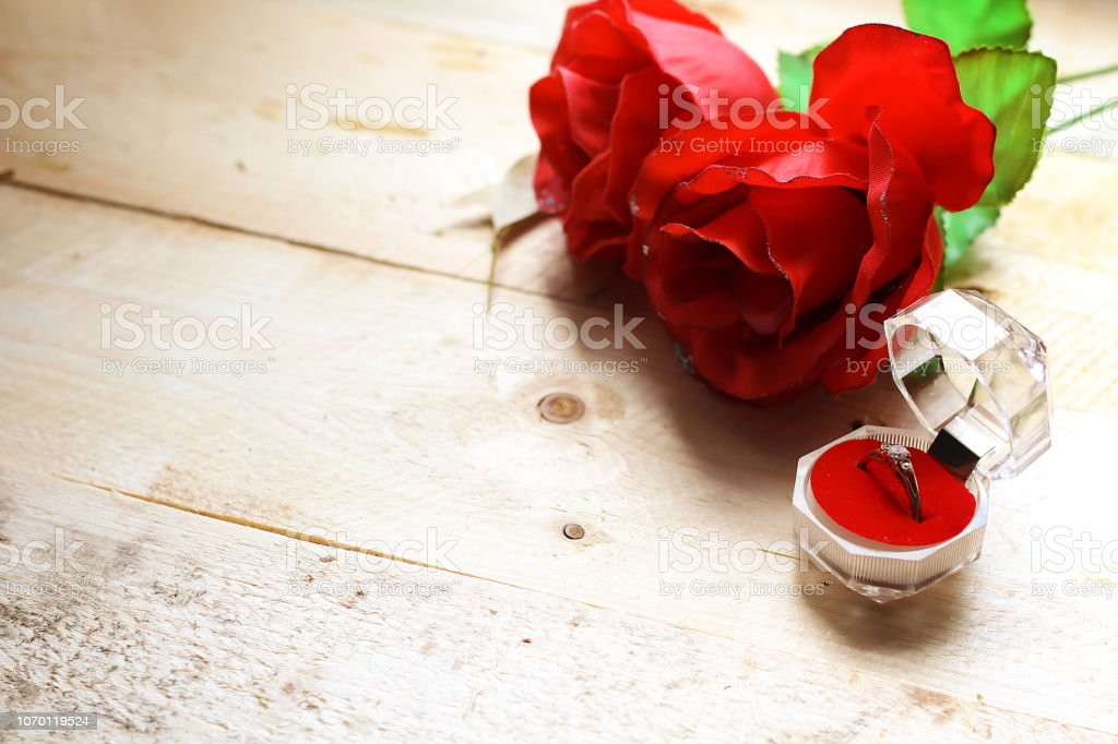 beautiful red roses flowers and ring alliance in box, wedding concept