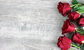 istock Beautiful Red Roses Over Rustic Wooden Background 905251266
