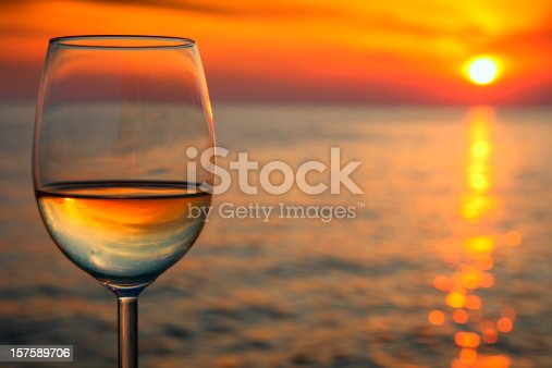 873264516istockphoto Beautiful red sunset  and glass of wine 157589706