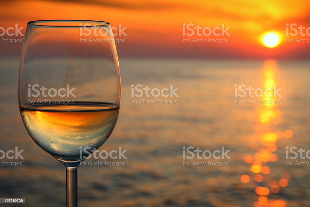 Beautiful red sunset  and glass of wine stock photo