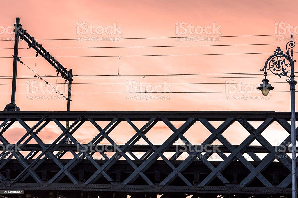 Beautiful red sunset sky over city rail bridge, royalty-free stock photo