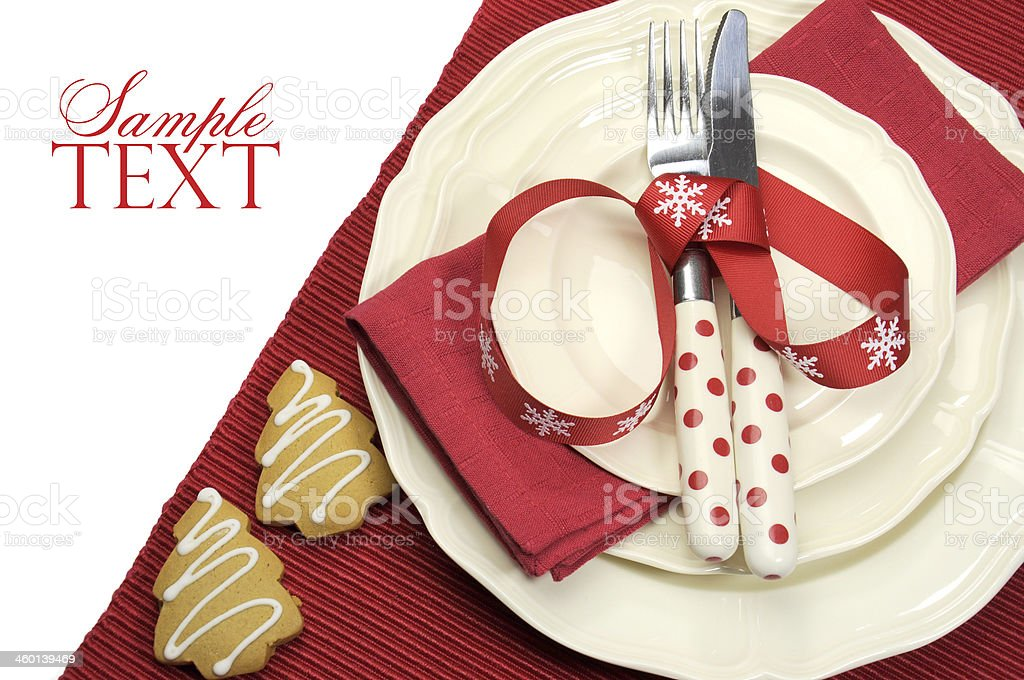 Beautiful red theme festive Christmas dining table place setting stock photo
