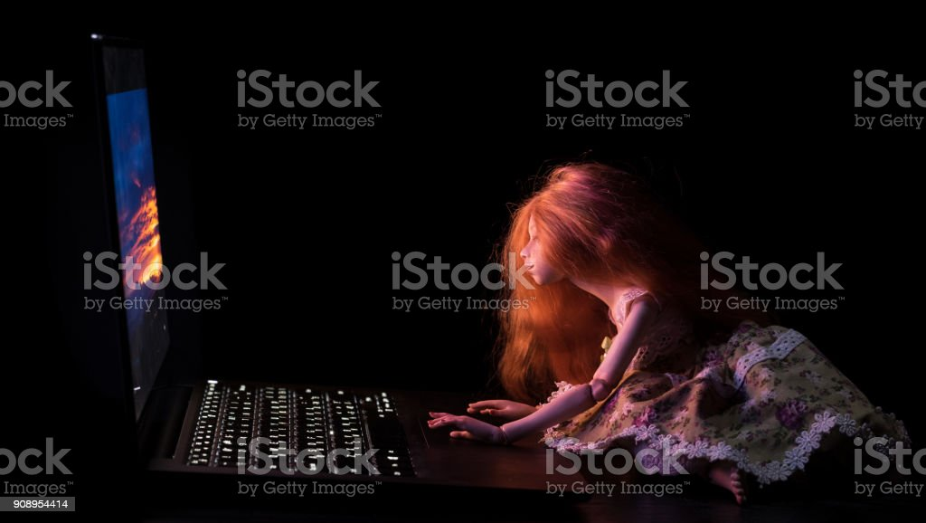 Beautiful red-haired doll stock photo
