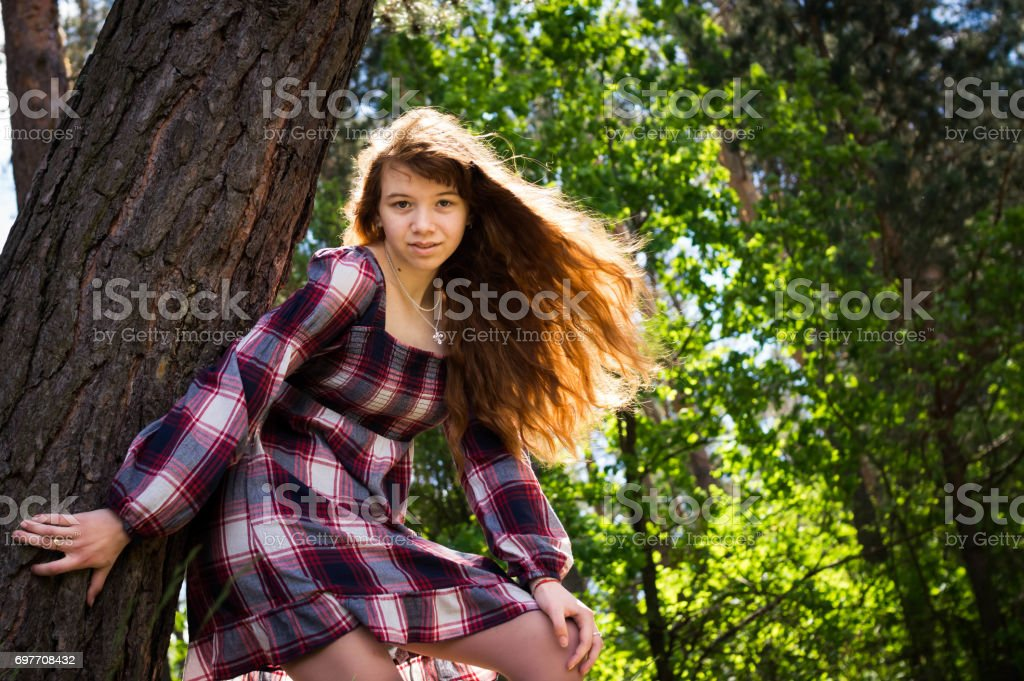 Halloween Costume 77084.Beautiful Redhaired Girl Sitting Under A Tree The Wind Develops Her