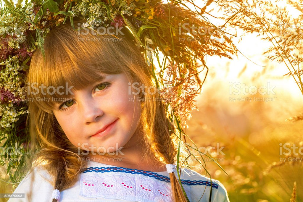 Beautiful red-haired little girl in wreath stok fotoğrafı