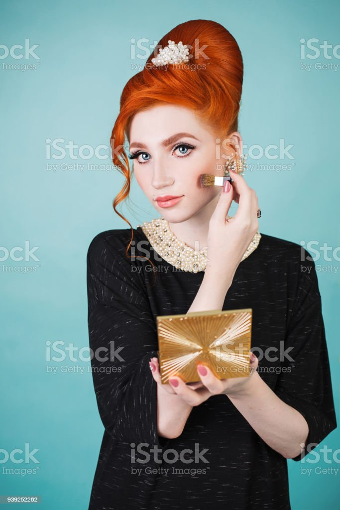 Beautiful Redhaired Woman With Retro Hairstyle And Makeup Is Holding