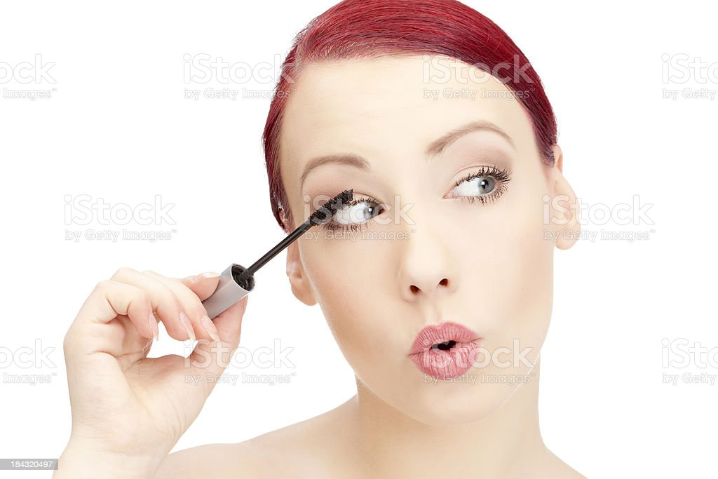 Beautiful redhead girl applying make up royalty-free stock photo