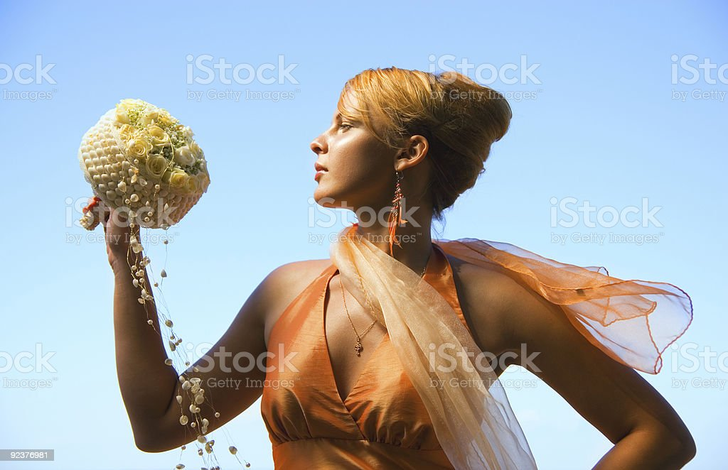 Beautiful redhead girl with a bouquet of flowers royalty-free stock photo