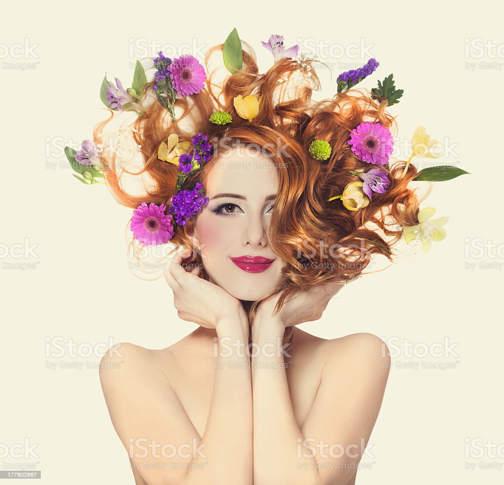 Beautiful redhead girl with flowers isolated. stock photo