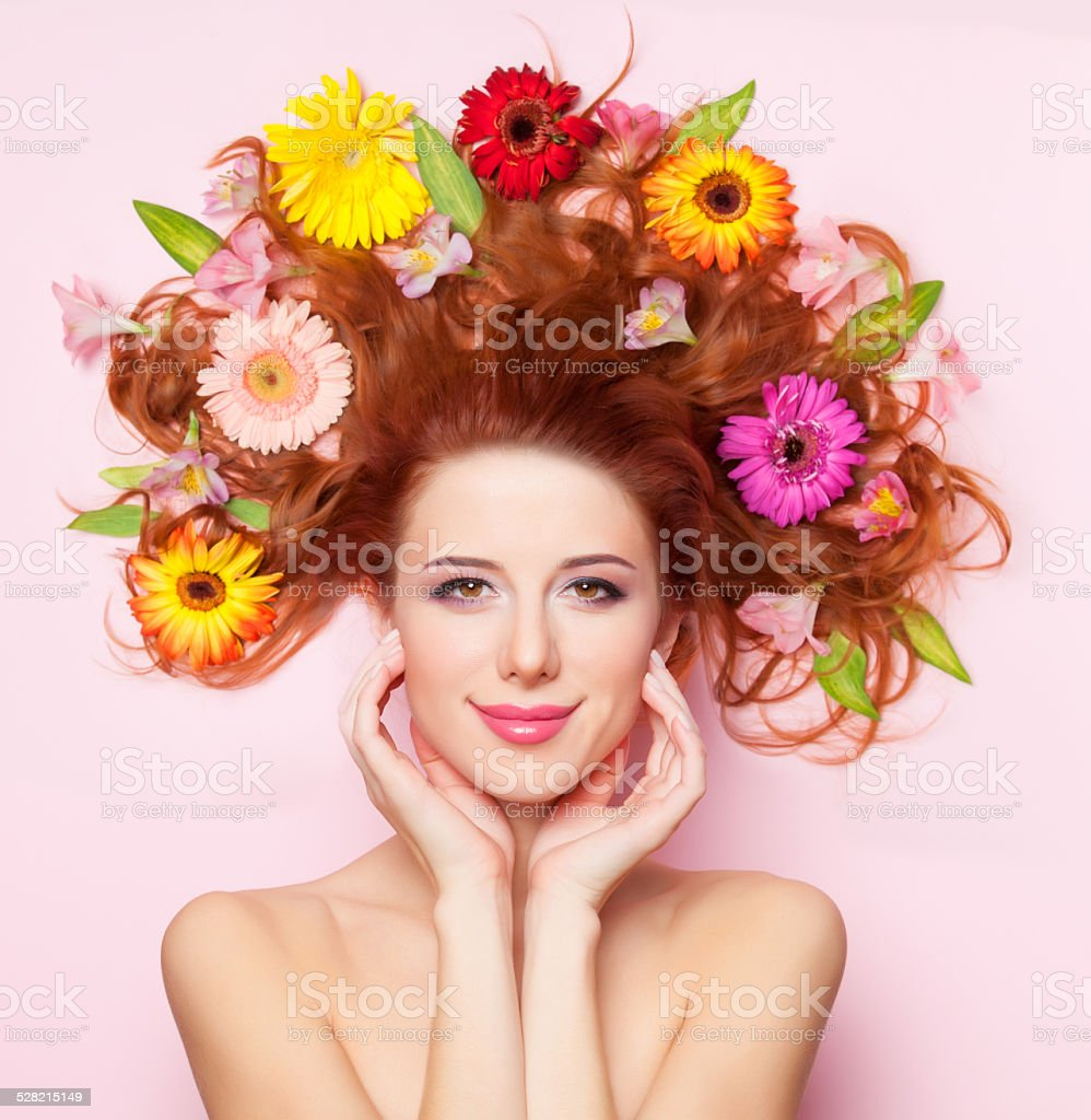 Beautiful Redhead Girl With Flowers On Pink Background Stock Photo